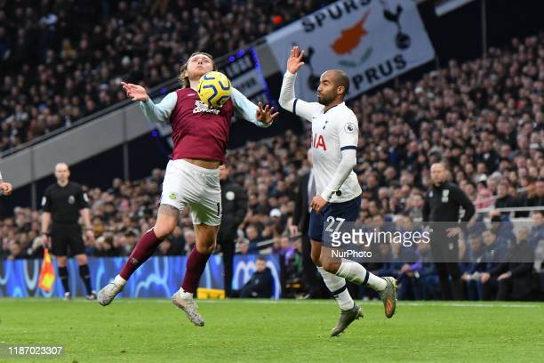 LONDON ENGLAND DECEMBER 7TH Jeff Hendrick of Burnley battles for possession with Lucas Moura of Tottenham during the Premier League match between...