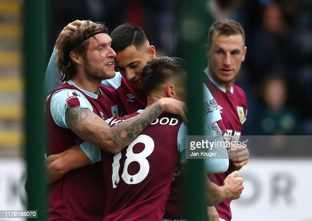 Jeff Hendrick of Burnley celebrates after scoring his team's first goal with his team mates during the Premier League match between Burnley FC and...