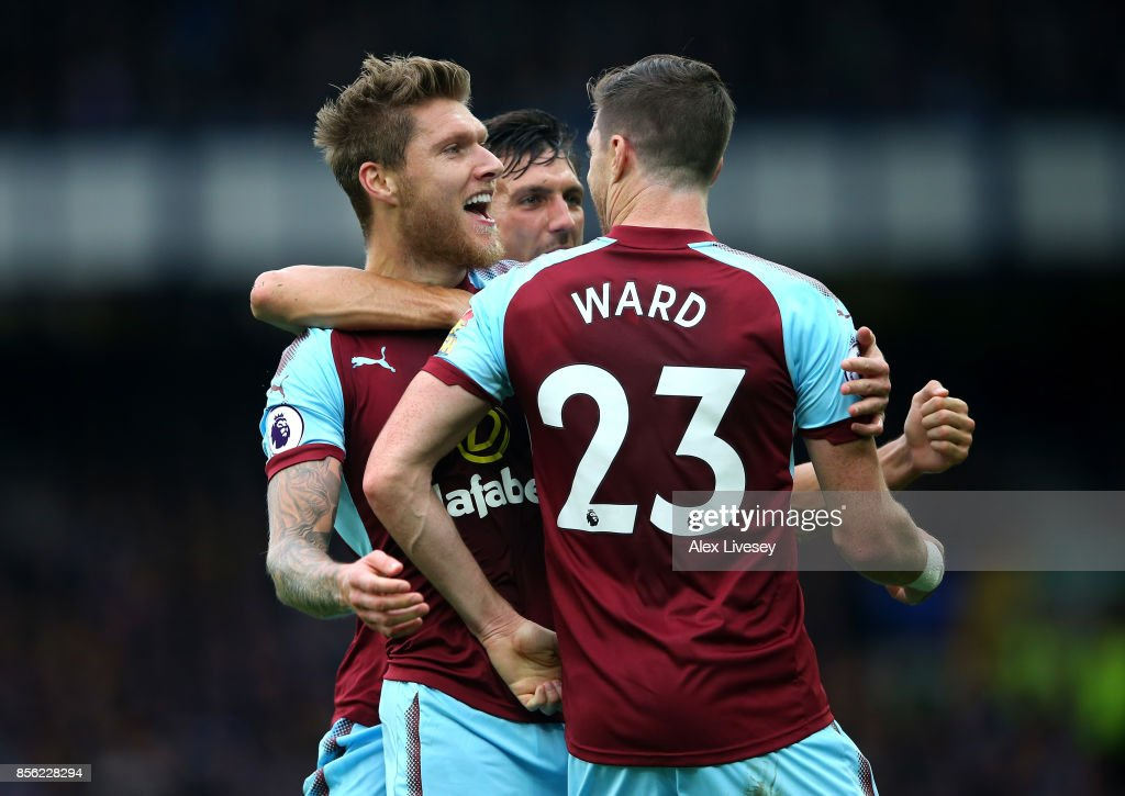Jeff Hendrick of Burnley celebrates scoring his sides first goal with Stephen Ward of Burnley and Jack Cork of Burnley during the Premier League match between Everton and Burnley at Goodison Park on October 1, 2017 in Liverpool, England.