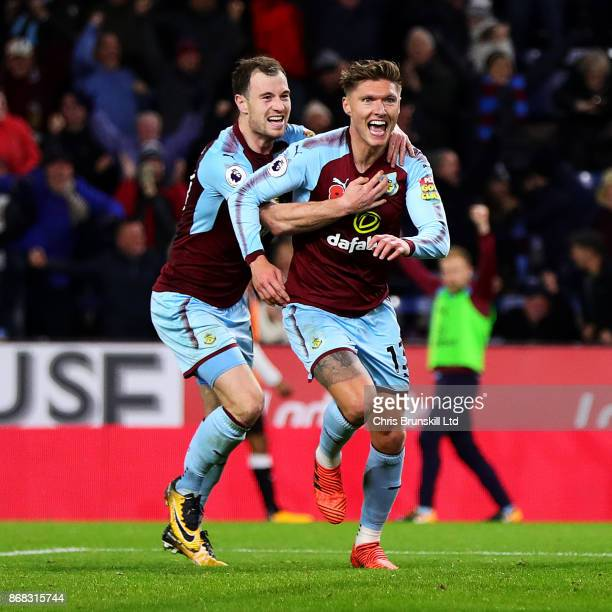 Jeff Hendrick of Burnley celebrates scoring the opening goal with teammate Ashley Barnes during the Premier League match between Burnley and...
