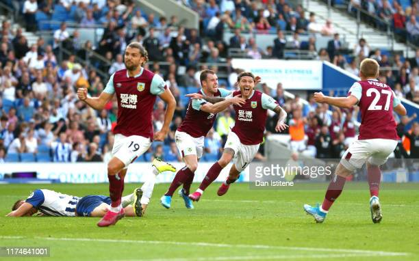 Jeff Hendrick of Burnley celebrates with teammate Ashley Barnes after scoring his team's first goal during the Premier League match between Brighton...