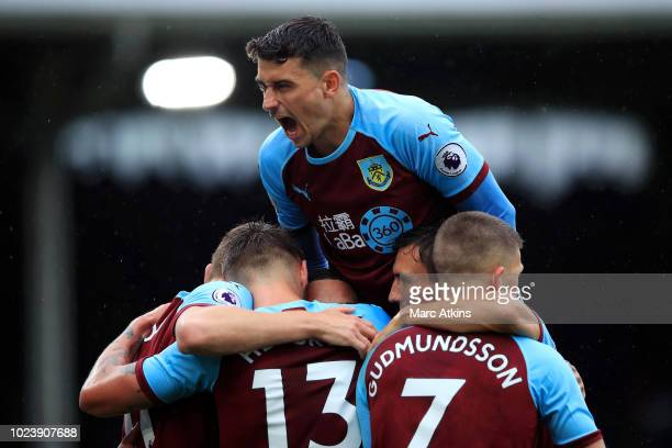Jeff Hendrick of Burnley celebrates with teammates after scoring his team's first goal during the Premier League match between Fulham FC and Burnley...