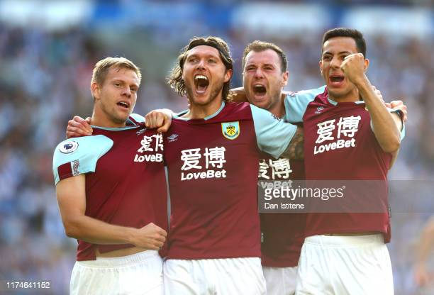 Jeff Hendrick of Burnley celebrates with teammates after scoring his team's first goal during the Premier League match between Brighton Hove Albion...