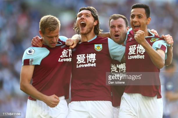 Jeff Hendrick of Burnley celebrates with teammates after scoring his team's first goal during the Premier League match between Brighton & Hove Albion...