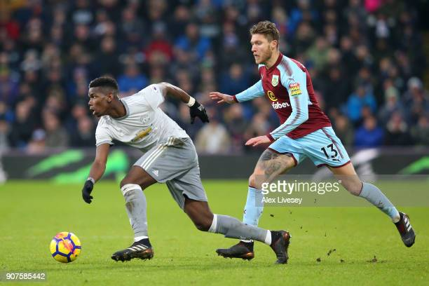Jeff Hendrick of Burnley chases down Paul Pogba of Manchester United during the Premier League match between Burnley and Manchester United at Turf...