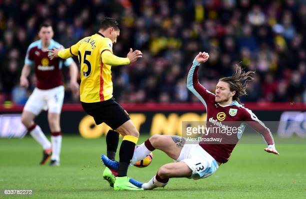Jeff Hendrick of Burnley fouls on Jose Holebas of Watford resulting in the red card during the Premier League match between Watford and Burnley at...
