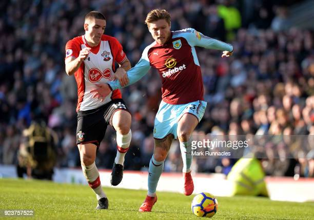 Jeff Hendrick of Burnley is challenged by Oriol Romeu of Southampton during the Premier League match between Burnley and Southampton at Turf Moor on...