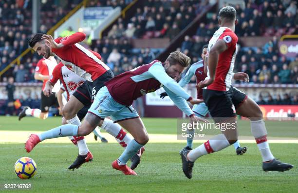 Jeff Hendrick of Burnley is challenged by Wesley Hoedt of Southampton and Mario Lemina of Southampton during the Premier League match between Burnley...