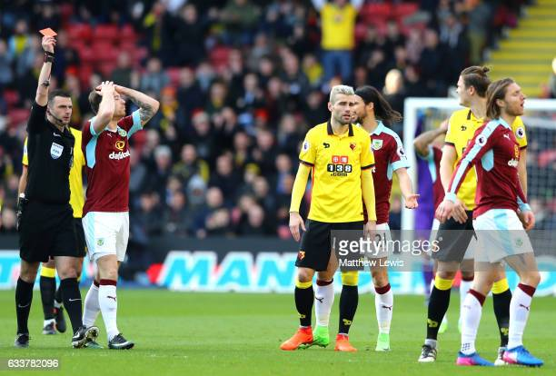 Jeff Hendrick of Burnley is shown a red card by Referee Michael Oliver shows a red card to Jeff Hendrick of Burnley during the Premier League match...
