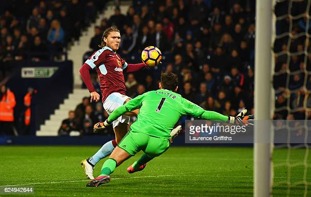 Jeff Hendrick of Burnley misses a chance as Ben Foster of West Bromwich Albion attempts to block during the Premier League match between West...