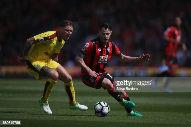Jeff Hendrick of Burnley puts pressure on Adam Smith of AFC Bournemouth during the Premier League match between AFC Bournemouth and Burnley at...