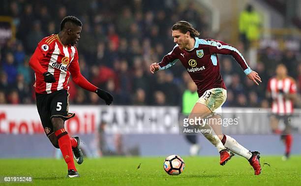 Jeff Hendrick of Burnley runs at Papy Djilobodji of Sunderland during the Emirates FA Cup third round replay between Burnley and Sunderland at Turf...