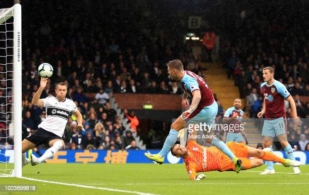 Jeff Hendrick of Burnley scores his team's first goal past Marcus Bettinelli of Fulham during the Premier League match between Fulham FC and Burnley...
