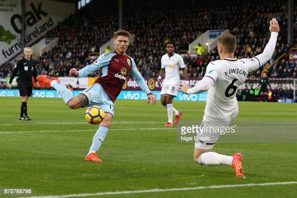 Jeff Hendrick of Burnley shoots under pressure from Alfie Mawson of Swansea City during the Premier League match between Burnley and Swansea City at...