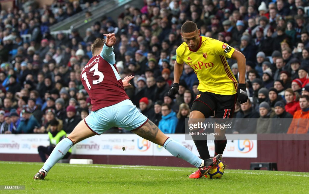 Jeff Hendrick of Burnley tackles Richarlison de Andrade of Watford during the Premier League match between Burnley and Watford at Turf Moor on December 9, 2017 in Burnley, England.