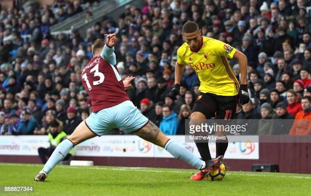 Jeff Hendrick of Burnley tackles Richarlison de Andrade of Watford during the Premier League match between Burnley and Watford at Turf Moor on...