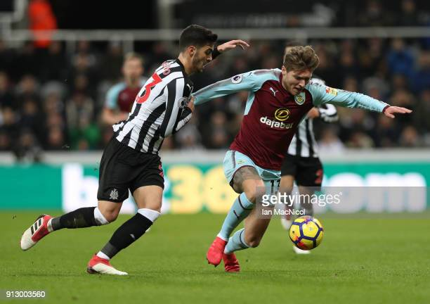 Jeff Hendrick of Burnley vies with Mikel Merino of Newcastle United during the Premier League match between Newcastle United and Burnley at St James...