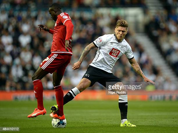 Jeff Hendrick of Derby County challenges Albert Adomah of Middlesbrough during the Sky Bet Championship match between Derby County and Middlesbrough...