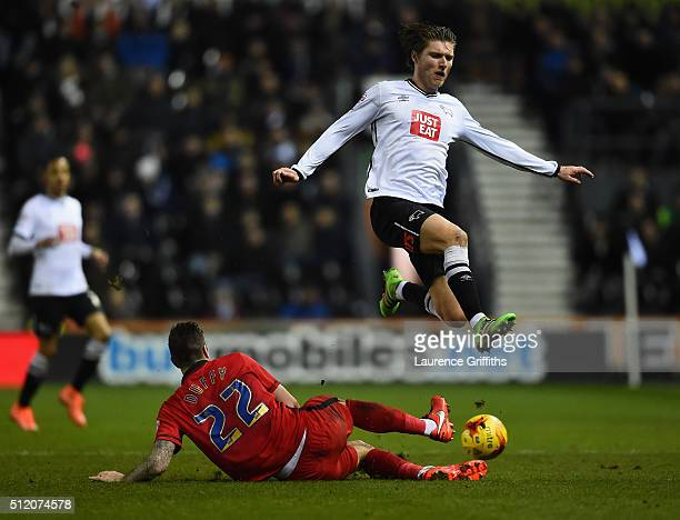 Jeff Hendrick of Derby County leaps over Shane Duffy of Blackburn Rovers during the Sky Bet Championship match between Derby County and Blackburn...