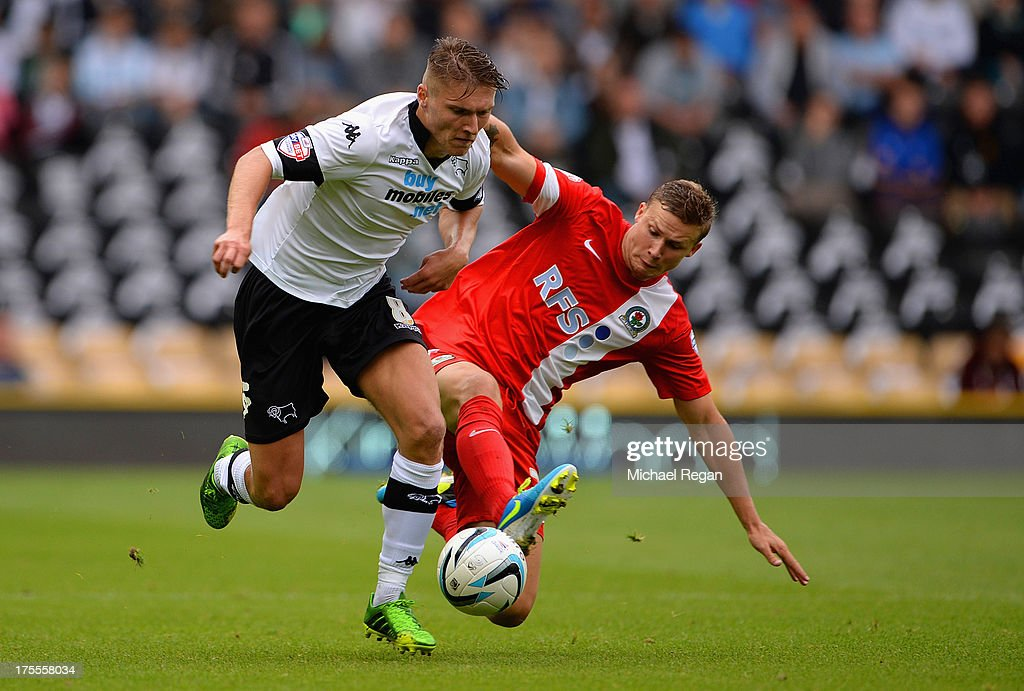 Jeff Hendrick of Derby in action with Alex Marrow of Blackburn during the Sky Bet Championship match between Derby County and Blackburn Rovers at Pride Park Stadium on August 04, 2013 in Derby, England,