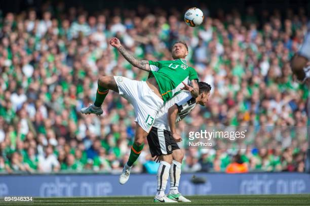 Jeff Hendrick of Ireland jumps for the ball with Zlatko Junuzovic of Austria during the FIFA World Cup 2018 Qualifying Round Group D match between...