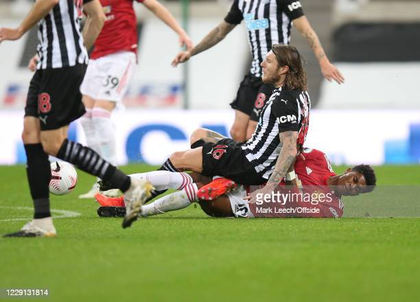 Jeff Hendrick of Newcastle lands on Marcus Rashford of Man Utd during the Premier League match between Newcastle United and Manchester United at St...