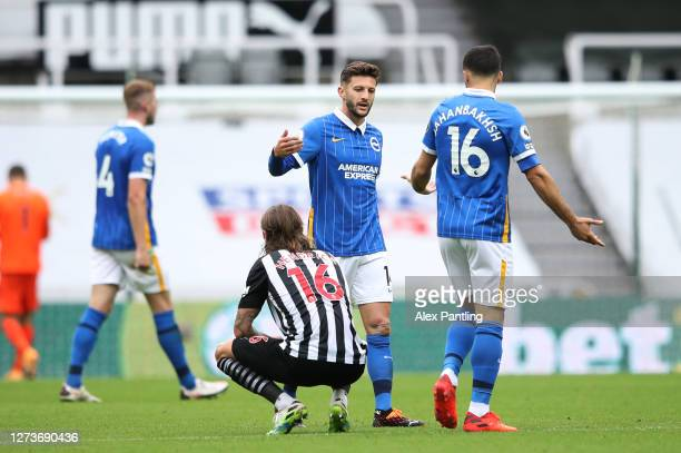 Jeff Hendrick of Newcastle United looks dejected following his teams defeat as Adam Lallana and Alireza Jahanbakhsh of Brighton and Hove Albion...