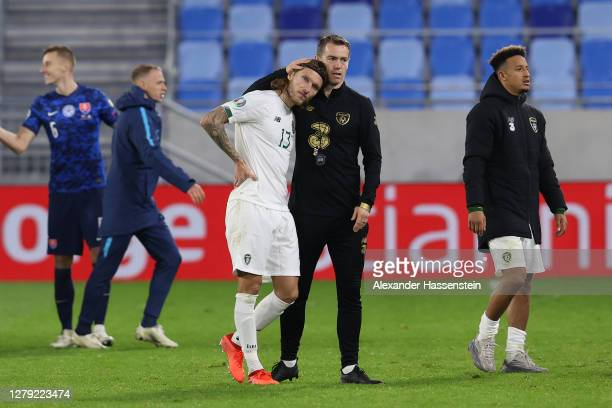 Jeff Hendrick of Republic of Ireland is consoled by a member of coaching staff following defeat in the penalty shoot out during the UEFA EURO 2020...