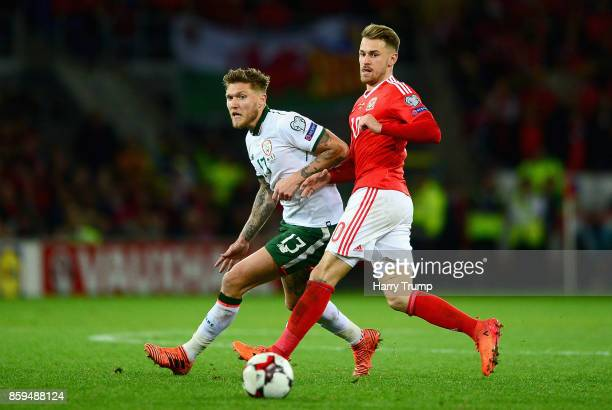 Jeff Hendrick of the Republic of Ireland and Aaron Ramsey of Wales battle for possession during the FIFA 2018 World Cup Group D Qualifier between...