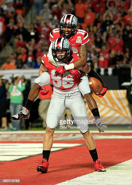 Jeff Heuerman and Philly Brown of the Ohio State Buckeyes celebrate after a touchdown by Heuerman in the second quarter against the Clemson Tigers...