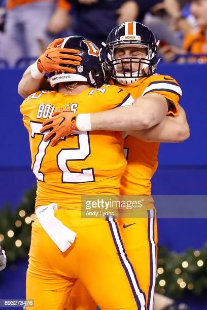 Jeff Heuerman of the Denver Broncos celebrates with Garett Bolles after a touchdown against the Indianapolis Colts during the second half at Lucas...