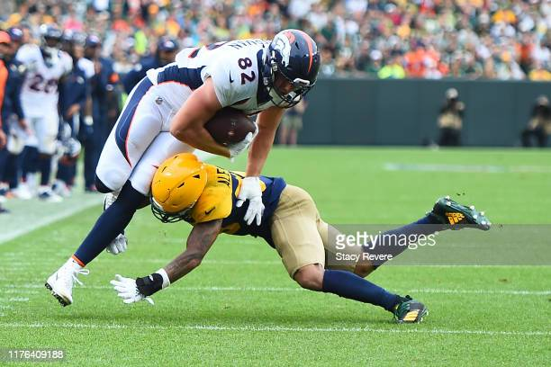 Jeff Heuerman of the Denver Broncos is brought down by Jaire Alexander of the Green Bay Packers during the second half at Lambeau Field on September...