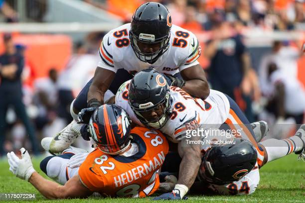 Jeff Heuerman of the Denver Broncos is tackled by Roquan Smith, Danny Trevathan and Leonard Floyd of the Chicago Bears during the second half at...