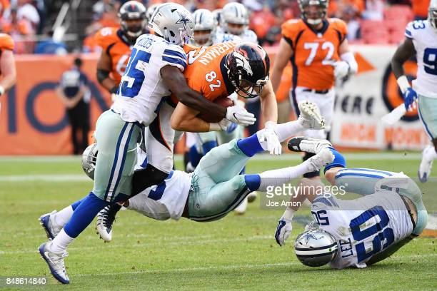Jeff Heuerman of the Denver Broncos is tackled by Xavier Woods of the Dallas Cowboys, Kavon Frazier , and Sean Lee during the third quarter on...