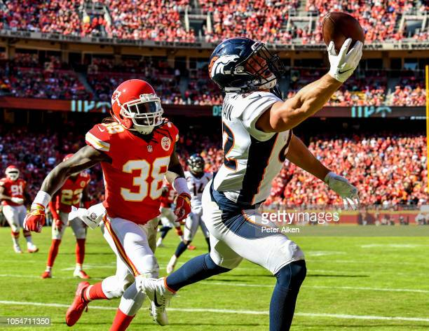 Jeff Heuerman of the Denver Broncos reaches out trying to make a catch in from of Ron Parker of the Kansas City Chiefs during the second half of the...