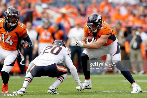 Jeff Heuerman of the Denver Broncos tries to elude Prince Amukamara of the Chicago Bears at Empower Field at Mile High on September 15 2019 in Denver...
