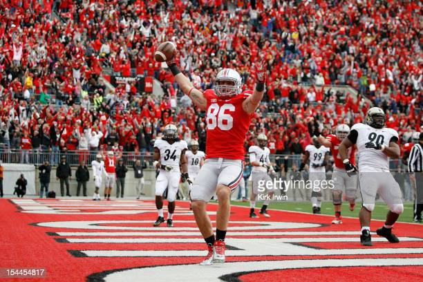 Jeff Heuerman of the Ohio State Buckeyes celebrates after catching a two point conversion against the Purdue Boilermakers to send the game into...