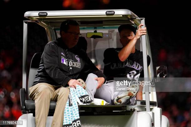 Jeff Hoffman of the Colorado Rockies is carted off the field after being hit in the leg with a line drive during the fourth inning against the San...