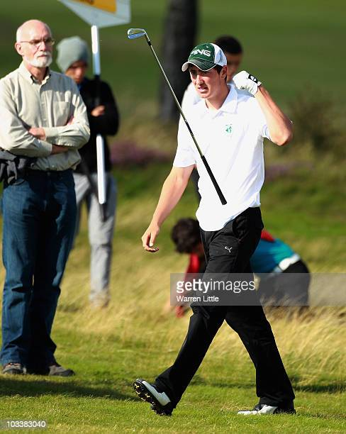 Jeff Hopkins of Ireland reacts after a poor second shot on the 16th hole during his semi final match against Max Rottluff of Germany for the Boys...