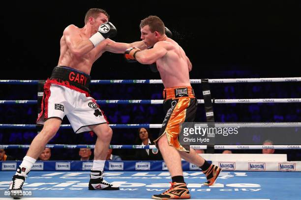 Jeff Horn and Gary Corcoran exchange punches during the WBO Welterweight Championship bout between Jeff Horn and Gary Corcoran at Brisbane Convention...