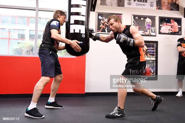 Jeff Horn hits the bag with Trainer Glenn Rushton during a training session on June 5 2018 in Las Vegas Nevada