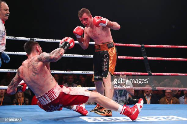 Jeff Horn knocks down Michael Zerafa during the middleweight bout at Brisbane Convention Exhibition Centre on December 18 2019 in Brisbane Australia
