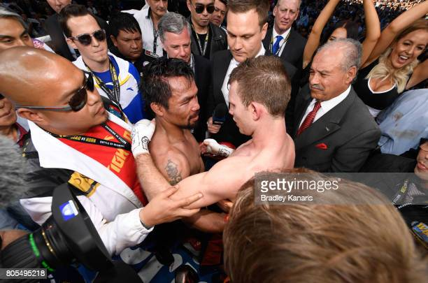 Jeff Horn of Australia embraces Manny Pacquiao of the Philippines after their WBO welterweight championship title fight at Suncorp Stadium on July 2...