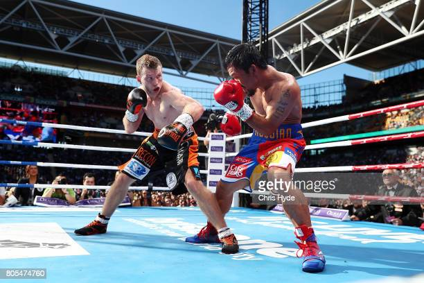 Jeff Horn of Australia punches Manny Pacquiao of the Philippines during the WBO World Welterweight Title Fight at Suncorp Stadium on July 2 2017 in...