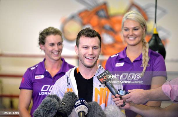 Jeff Horn speaks at a press conference alongside Netball players Gabi Simpson and Gretel Tippett before a sparring session with Ray Robinson at...