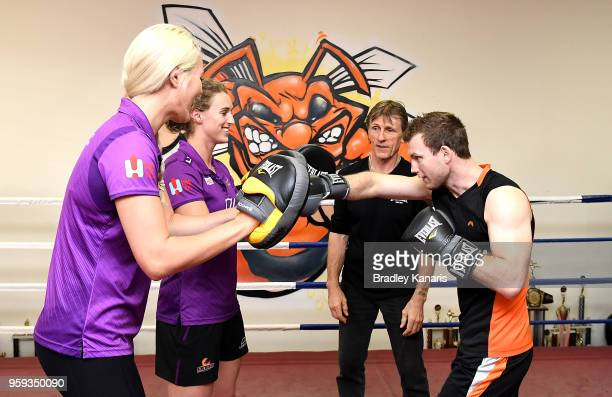 Jeff Horn trains with Queensland Firebirds players Gabi Simpson and Gretel Tippett bfeore a sparring session with Ray Robinson at Stretton Boxing...