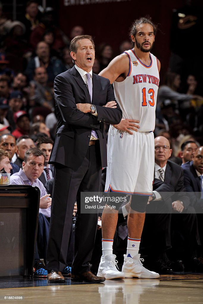 Jeff Hornacek and Joakim Noah #13 of the New York Knicks stand by the bench before the game against the Cleveland Cavaliers on October 25, 2016 at Quicken Loans Arena in Cleveland, Ohio.