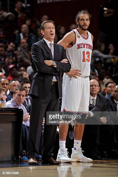 Jeff Hornacek and Joakim Noah of the New York Knicks stand by the bench before the game against the Cleveland Cavaliers on October 25 2016 at Quicken...