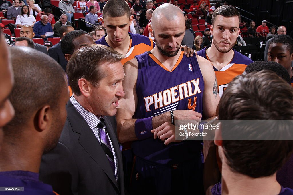 Jeff Hornacek huddles up the Phoenix Suns during the game against the Portland Trail Blazers on October 9, 2013 at the Moda Center Arena in Portland, Oregon.