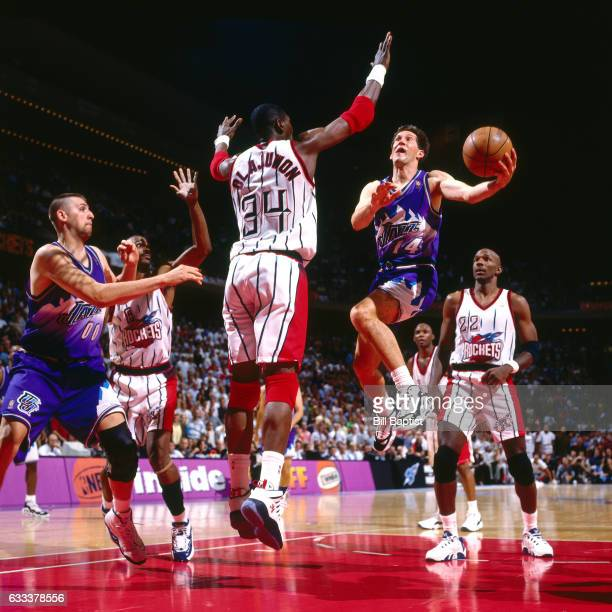 Jeff Hornacek of the Utah Jazz shoots against Hakeem Olajuwon of the Houston Rockets during Game Six of the Western Conference Finals on May 29 1997...